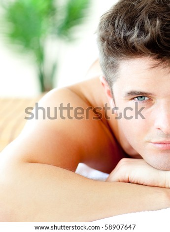 Close-up of an attractive man in a spa center having a massage - stock photo