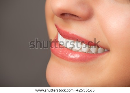 Close-up of an attractive woman's smile. - stock photo