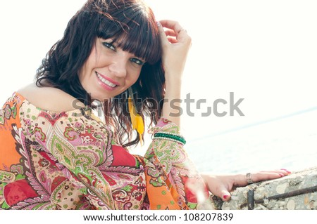 Close-up of an attractive young female standing near the shore - stock photo