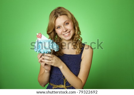 Close-up of an attractive young woman holding a gift bouquet of blue chrysanthemums. In flowers of a romantic note
