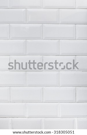 Close-up of an authentic kitchen white tile wall. - stock photo