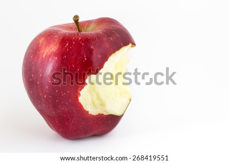 Close-up of an bitten apple on white background and copy space. - stock photo
