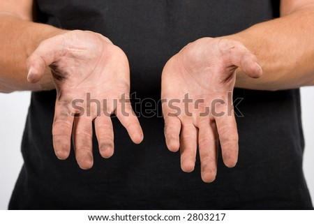 close up of an Caucasian worker with dirty hands,