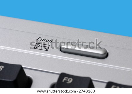 Close-up of an e-mail envelope icon on a computer keyboard. - stock photo