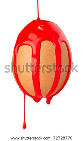 close up of an egg with leaking red paint on white background with clipping path - stock photo