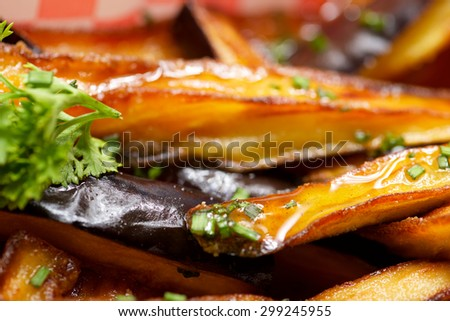 Close-up of an eggplant dish with honey. - stock photo
