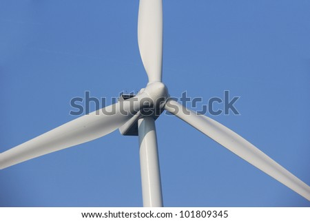Close up of an electrical power generating wind turbine. - stock photo