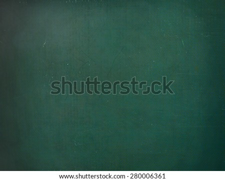 close up of an empty school chalkboard - stock photo