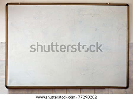 close up of an empty  white chalk board - stock photo