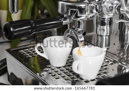 Close-up of an espresso machine making a cup of coffee - stock photo