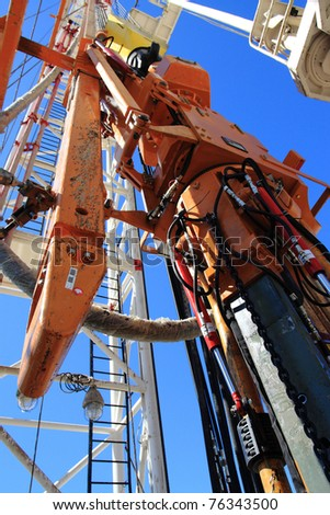 Close up of an oil pump with blue sky - stock photo