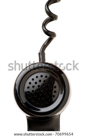 Close up of an old and scratched  phone handset handing by the chord isolated over a white background. - stock photo