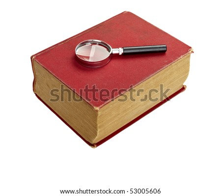 close up of an old book  and magnifying glass on white background with clipping path - stock photo