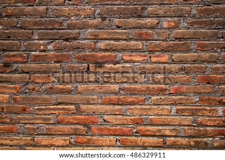 close-up of an old brick wall that is damaged