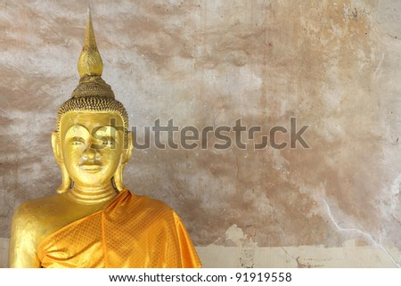 Close up of an old buddha statue at temple (Generality in Thailand,any kind of art decorated in Buddhist church etc.  created with money donated by people, no restrict in copy or use)