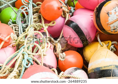 Close up of an old collection of brightly colored buoys on the Riverton jetty, Southland, NZ. - stock photo
