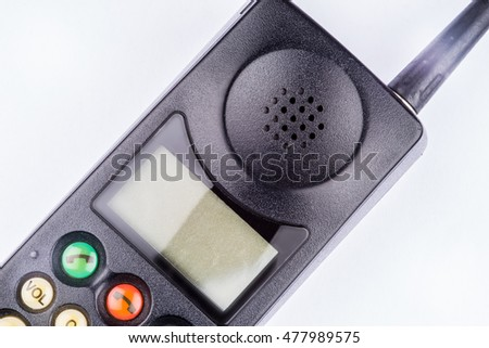 Close up of an old fashioned black vintage mobile  brick phone laid on a white background