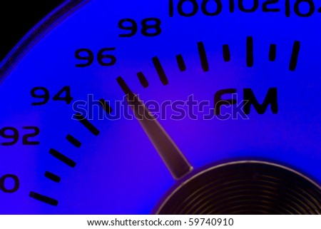 Close-up of an old fashioned FM dial in blue - stock photo