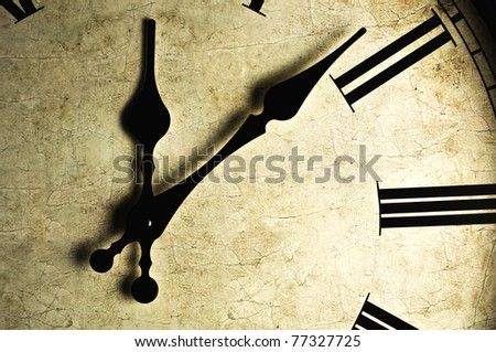 Close up of an old-fashioned wall clock. Studio work. - stock photo