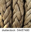 Close-up of an old frayed boat rope as a nautical background. - stock photo