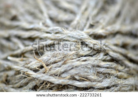Close-up of an old frayed boat rope as a nautical background. Sepia - stock photo