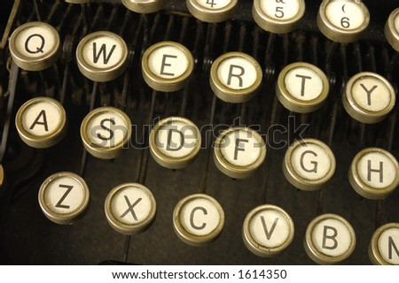 Close-up of an old, grungy, typewriter keyboard. - stock photo
