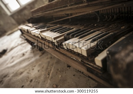 Close-up of an old piano keyboard in an abandoned auditorium in Pripyat. Chernobyl nuclear power plant zone of alienation - stock photo