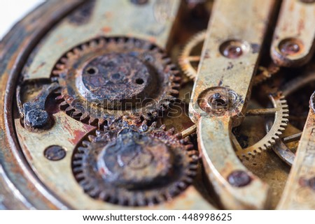 close up of an old pocket watch with rusty gears as a concept - stock photo