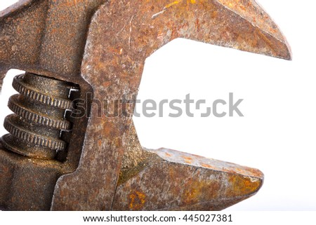 Close up of an old rusty adjustable wrench on a white background - stock photo