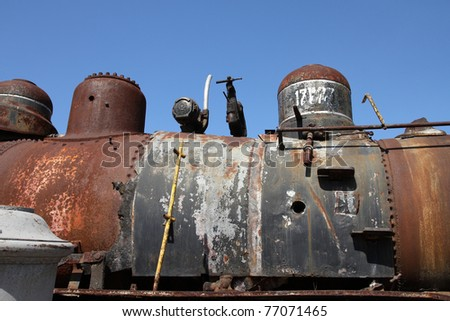 Close up of an old, rusty steam locomotive ready to be scrapped in Havana, Cuba
