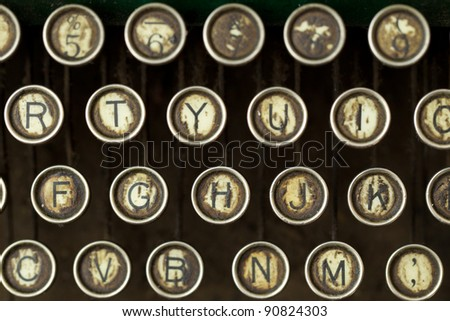 CLOSE UP OF AN OLD TYPEWRITER, SHALLOW DEPTH OF FIELD, FOCUS ON THE FGH ROW  - stock photo