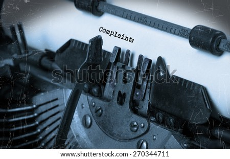 Close-up of an old typewriter with paper, perspective, selective focus, complain - stock photo
