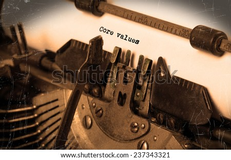 Close-up of an old typewriter with paper, perspective, selective focus, core values - stock photo