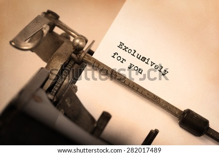 Close-up of an old typewriter with paper, perspective, selective focus, Exclusively for you - stock photo