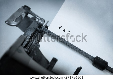 Close-up of an old typewriter with paper, perspective, selective focus, FAQ - stock photo
