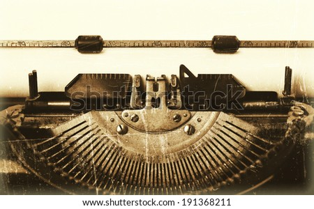 Close-up of an old typewriter with paper, vintage look - stock photo