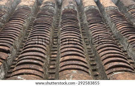 Close up of an old vintage curved earthenware tile in Hoi An ancient town, Vietnam. - stock photo