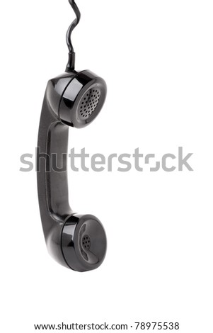 Close up of an old vintage phone handset hanging by the chord isolated over a white background. - stock photo