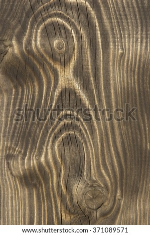 Close up of an old wooden plank with texture,grain, cracks and knots - stock photo