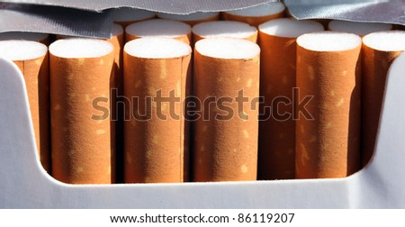 close up of an opened cigarettes box - stock photo