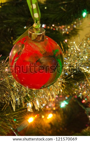 close up of an ornament, tinsel and lights on a Christmas tree - stock photo