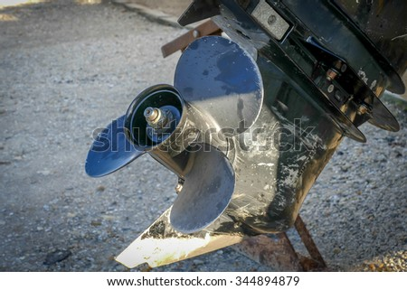 Close up of an outboard engine propeller. Outboard motor is a propulsion system for boats - stock photo