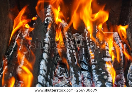 Close up of an outdoor fire burning. - stock photo