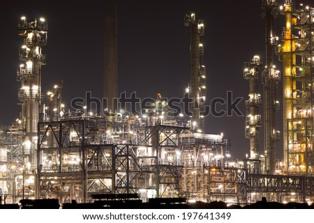 Close-up of an refinery plant at night - stock photo