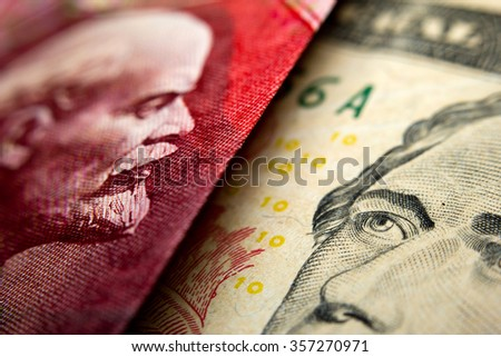 Close-up of an Russian ruble bill (showing Lenin) and a 10 dollar banknote figuring Alexander Hamilton - stock photo