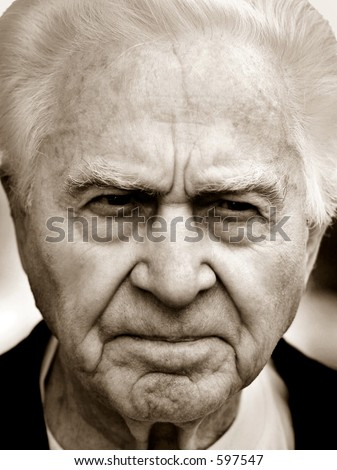 Close-up of an unhappy old man. - stock photo