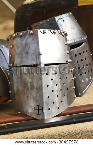 close up of ancient metal helmet   background - stock photo