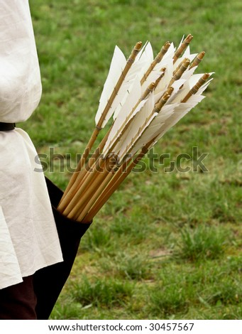 close up of ancient wood arrows  background - stock photo
