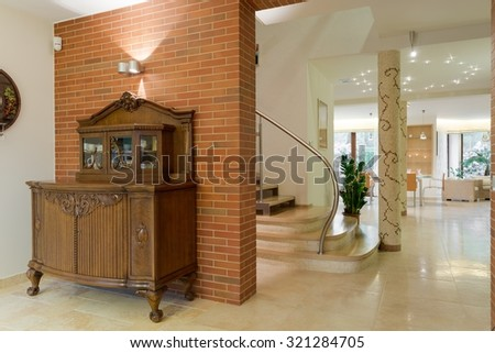 Close up of ancient wooden cabinet in new design interior - stock photo