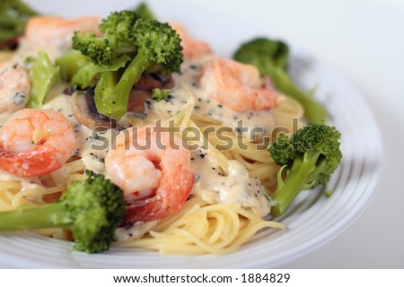 Close Up Of Angel Hair Pasta With Alfredo Sauce And Shrimp And Broccoli